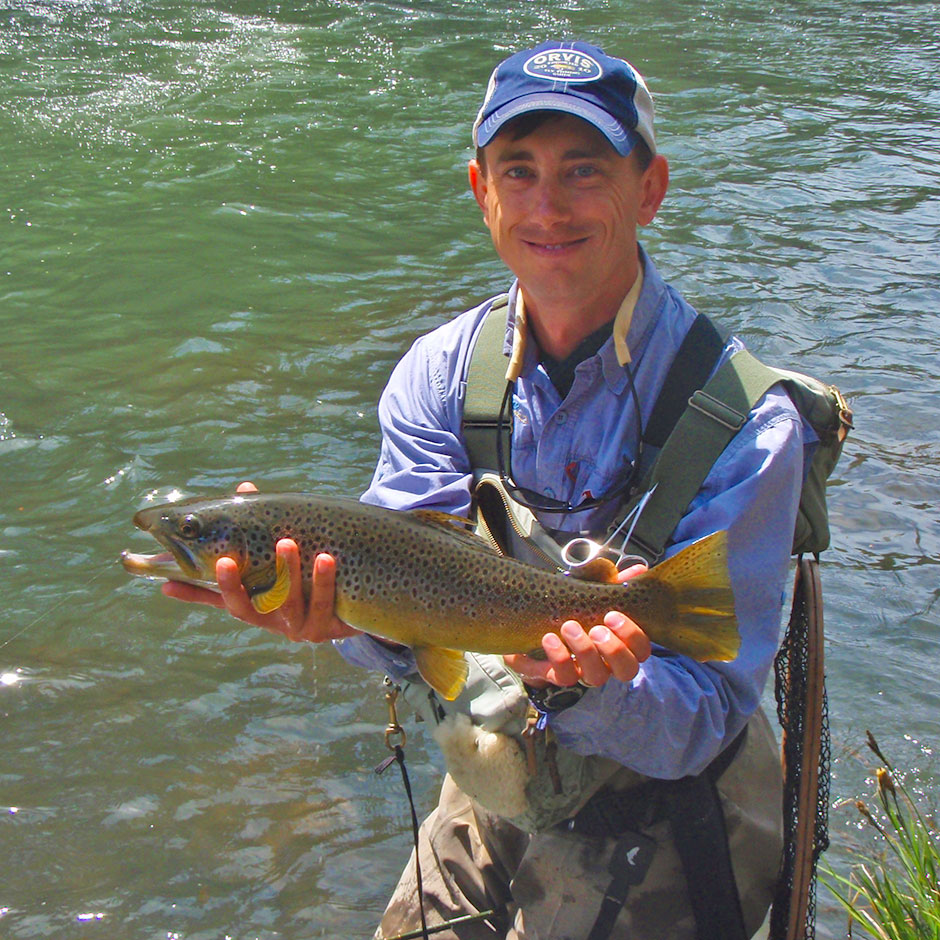 Guide Andrew Harris with a brown trout from the McCloud River
