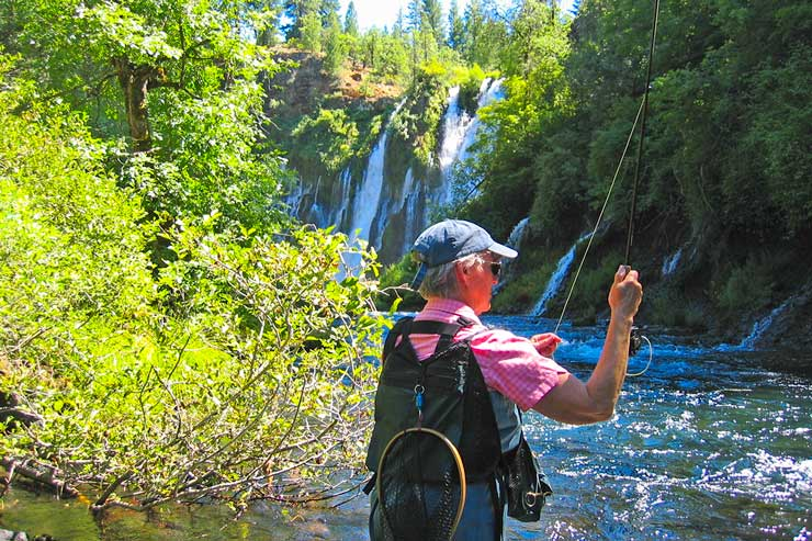 An angler casting a fly downstream from Burney Falls