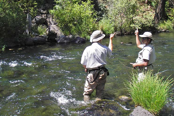 Guide Dax Messett helps his guest with the casting motion