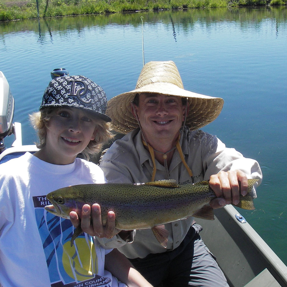 Guide Andrew Harris and guest with a rainbow trout from Fall River
