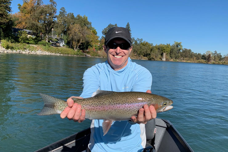 A guest with a great wild rainbow trout from the Lower Sac