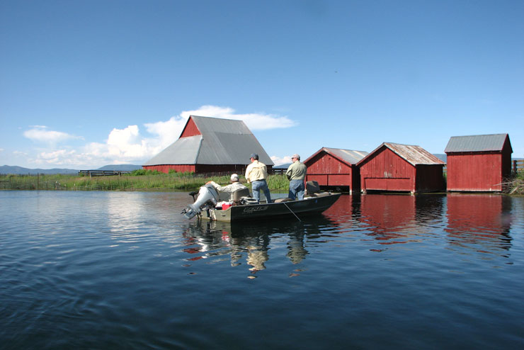 A guide fishing his clients near the Red Barns