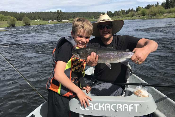 Guide Dylan Woodrum on a day off with his son on the Williamson River
